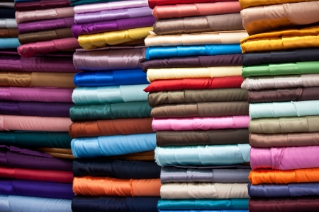 stacked colorful fabrics in the Grand Bazaar in Istanbul, Turkey  photo
