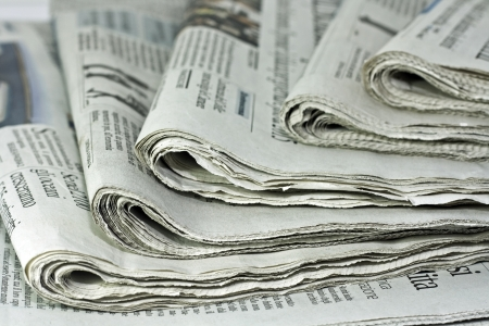 newspapers against plain background shot with very shallow depth of field photo