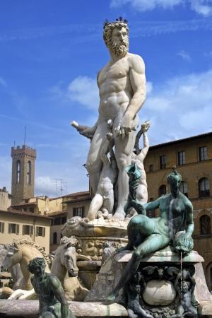 naked statue: The Neptune fountain, made by Ammannati, on the main square of Florence  Piazza della Signorio
