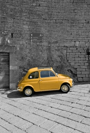parked: fiat 500 in a black - white background