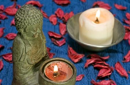 flame like: Buddha and candle - still life Stock Photo