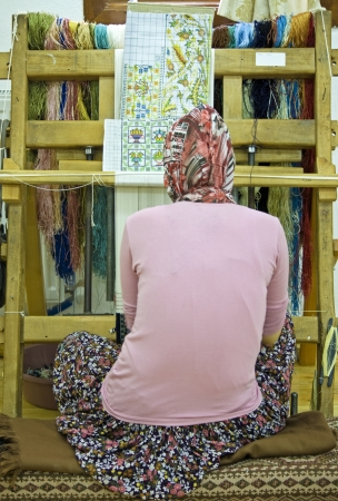 wooden loom with weaver - turkey