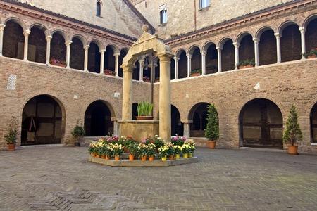 catholicity: Santo Stefano cloister in Bologna - italy