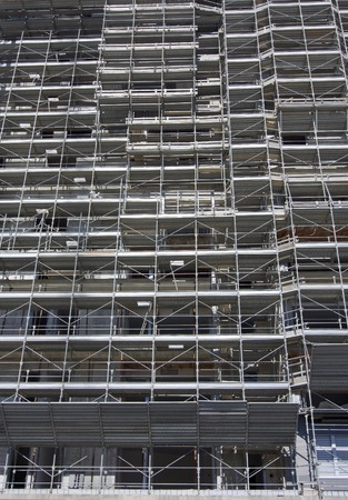 construction platform: Scaffolding on a construction site of a new building