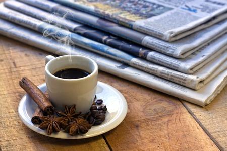 Coffee cup and newspaper - still life Stock Photo