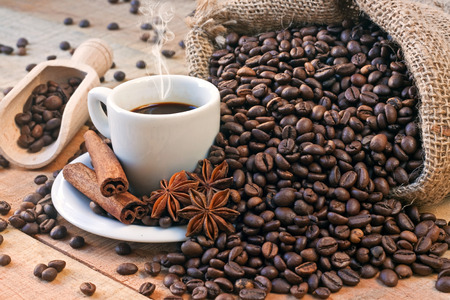 grains and coffee cup on wooden table photo