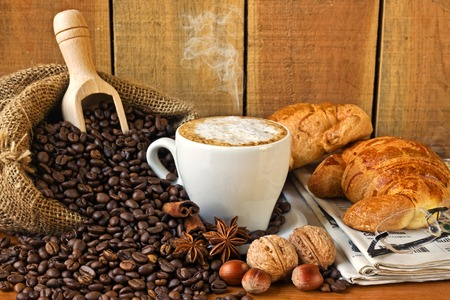 cappuccino, croissants and newspaper with background - still life photo