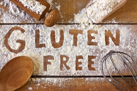 allergic ingredients: gluten free word with wood background Stock Photo