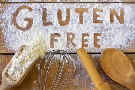 food allergy: gluten word with wood background