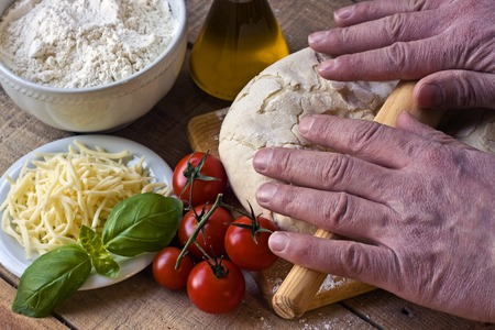 rolling: Dought for italian pizza preparation - Falling flour