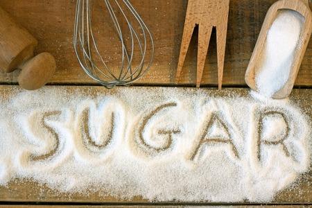 hypoglycaemia: a word with sugar background - still life