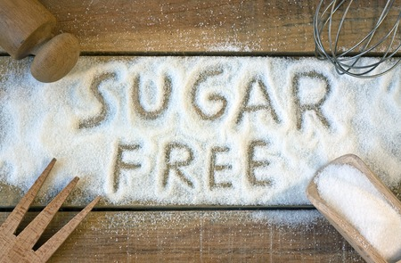 sugar cubes: a sugar free word with background - still life Stock Photo
