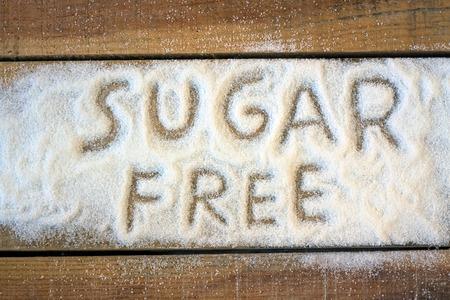 azucar: una palabra sin az�car con el fondo - la naturaleza muerta