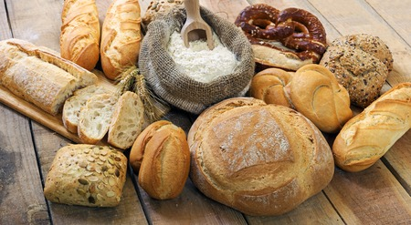 Different breads on wood background Stock Photo
