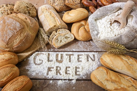 food allergy: a gluten free breads on wood background