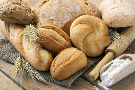 Different breads on wood background Archivio Fotografico