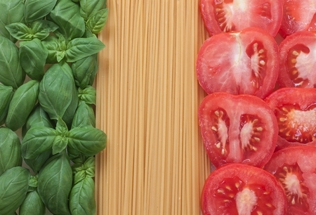 italian food with background - pasta, tomato, basil Imagens