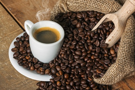 coffe beans: coffee on wood background, with bean