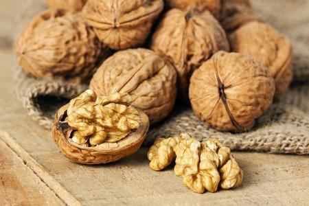 walnut: walnuts on wood background - food Stock Photo