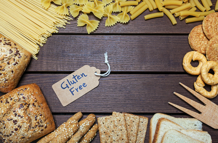 a gluten free foods on wood background - still life