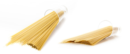 uncooked: Uncooked pasta spaghetti on white background Stock Photo
