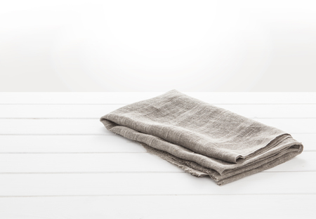 Kitchen towel on white wooden table. concept background for the product