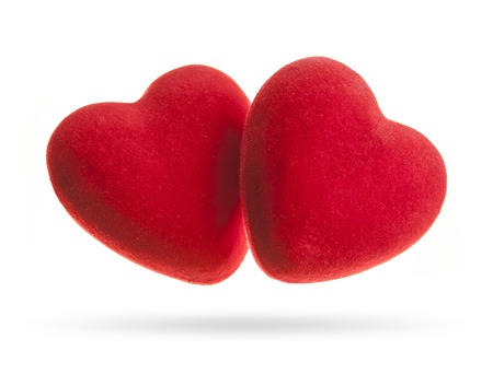 Two velvet hearts isolated on a white background. Concept for Valentine's Day Фото со стока