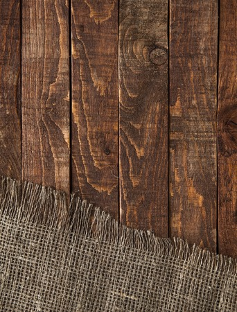 Burlap texture on wooden table background. Wooden table with sacking Фото со стока