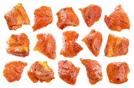 pancetta cubetti: Pieces of raw pork isolated on white background. Chunks of barbecue in a sauce isolated with a clipping path.