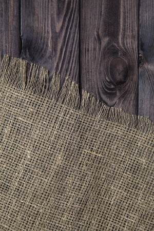 sacking: Burlap texture on wooden table background. Wooden table with sacking Stock Photo