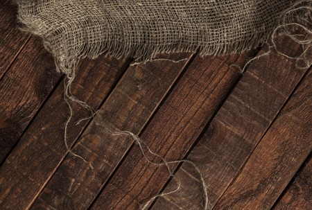 jute texture: jute texture on wooden table background. Wooden table with sacking