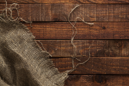 hessian: Hessian texture on wooden table background. Wooden table with sacking