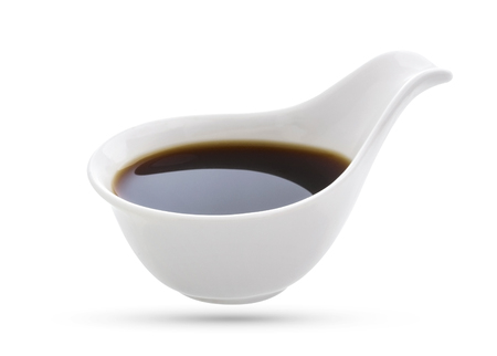 soy sauce: Bowl with soy sauce isolated on white background.