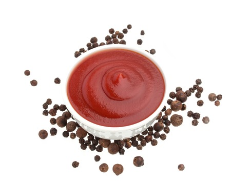 catsup: Ketchup in bowl and black pepper isolated on white background. Portion of tomato sauce.
