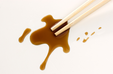 Soy sauce and chopsticks on white background, top view Stok Fotoğraf