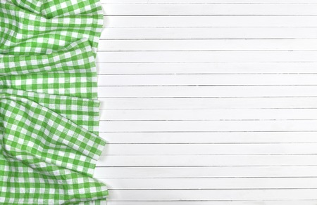 Green Checkered Tablecloth On Wooden Table, Top View Photo