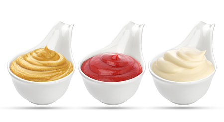 Ketchup, mustard, and mayonnaise sauces in bowl isolated on white background