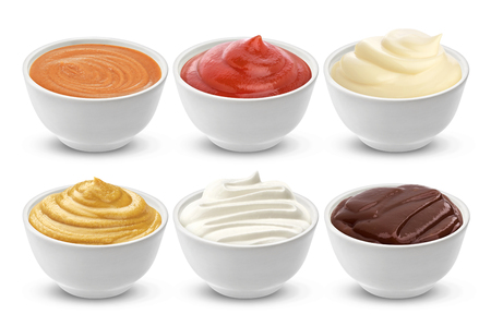 Set of different sauces isolated on white