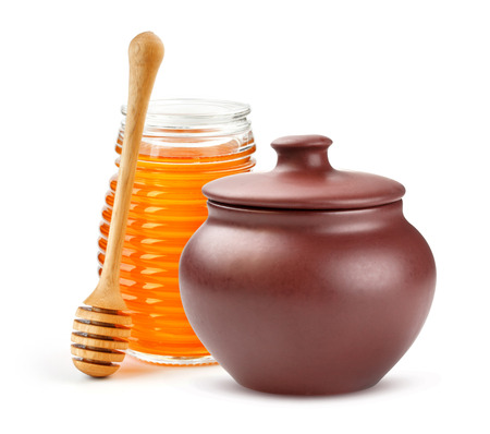Clay Honey pot and glass jar isolated on white background