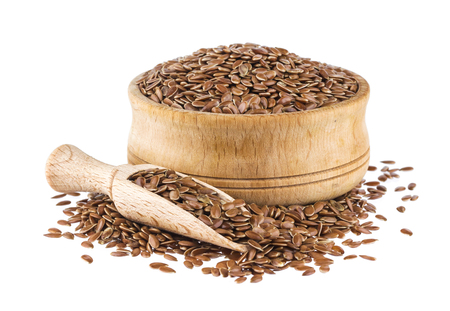 Flax seeds isolated on white background, close up of flaxseed in wooden scoop and bowl Stockfoto