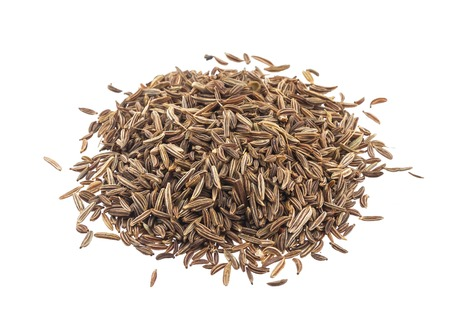 Cumin or caraway seeds isolated on white background. Top view