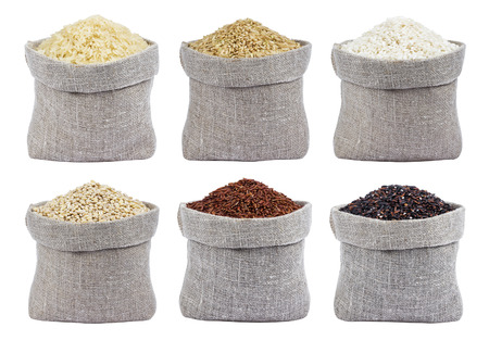 Different types of rice isolated on white background Stock Photo