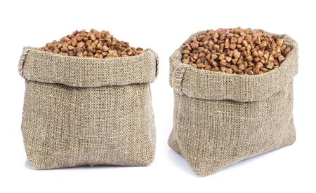 Buckwheat in bag isolated on white background Standard-Bild