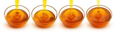 Pouring honey isolated on white background Stock Photo