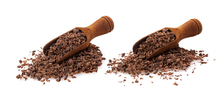 Grated chocolate. Pile of ground chocolate in wooden scoop isolated on white background, closeup