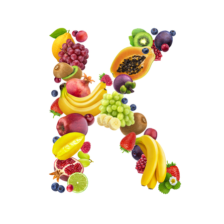 Letter K made of different fruits and berries, fruit font isolated on white background with clipping path, healthy alphabet Stock fotó