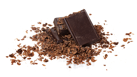 Broken chocolate. Heap of ground and grated chocolate isolated on white background