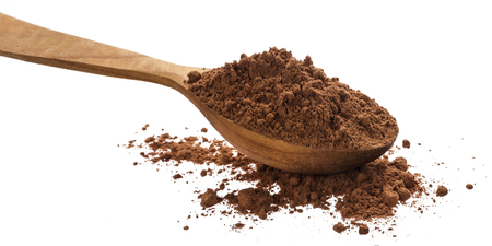 Pile of cocoa powder isolated on white background, cinnamon powder in wooden spoon. Reklamní fotografie