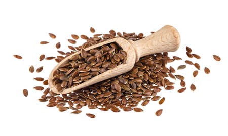 Pile of flax seeds isolated on white background, close-up of flaxseed in wooden scoop