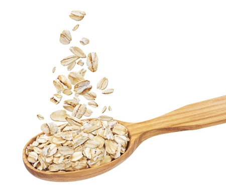 Isolated oatmeal, oat flakes in spoon, oat flakes isolated on white background with clipping path